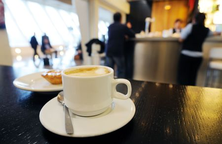 woman in cafe: morning coffee in airport