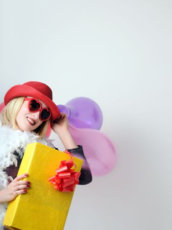 woman with balloons and present photo