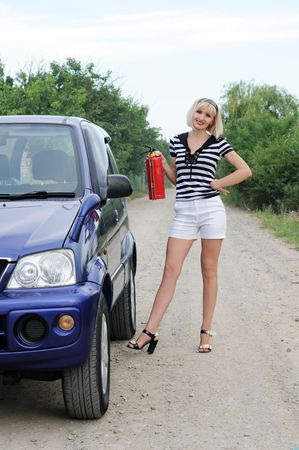 beautiful girl with fire extinguisher photo