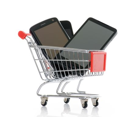 shopping trolley with smart phones Stock Photo