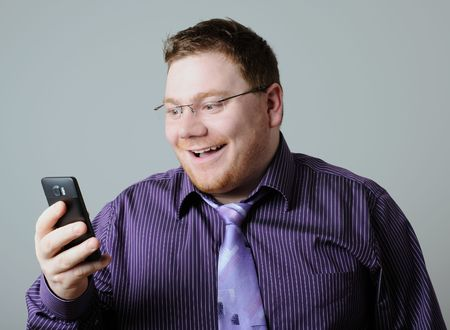 happy man with mobile phone Stock Photo - 6620588