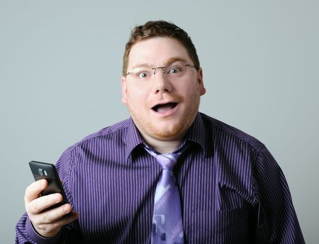 surprised man with mobile phone Stock Photo - 6620587
