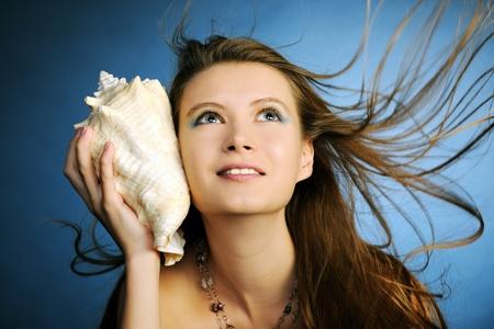 adult mermaid: girl with seashell Stock Photo
