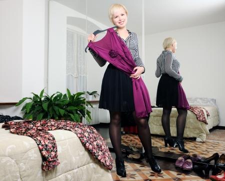 choosing clothes: choosing clothes Stock Photo