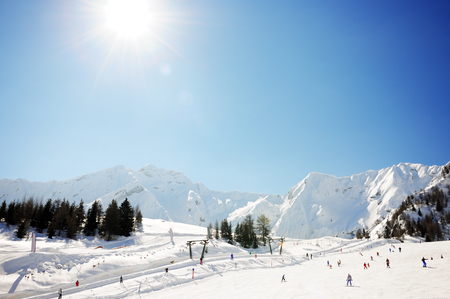 winter holiday: sunny day in winter alps Stock Photo