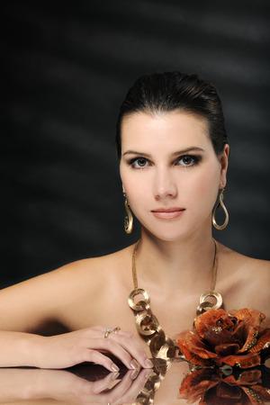 beautiful woman in golden jewelry
