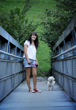 かわいい犬と陽気な女性 写真素材