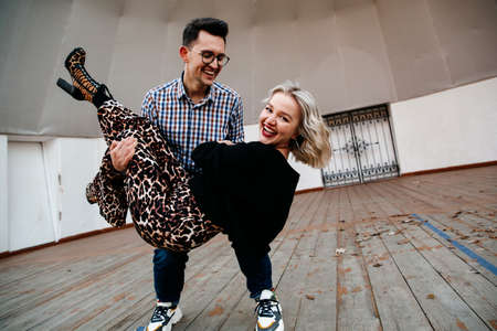 happy couple. A man is holding a woman in his arms and fooling around. have fun together