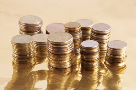 coins on a gold background