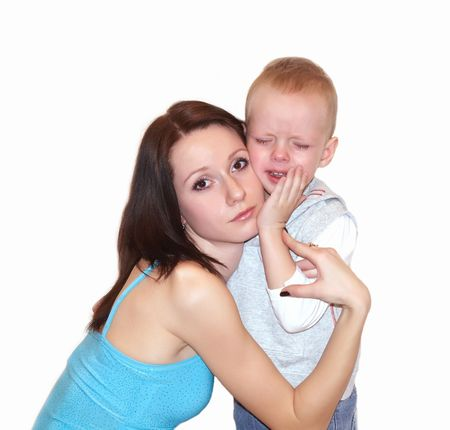 Mother embracing crying son Stock Photo