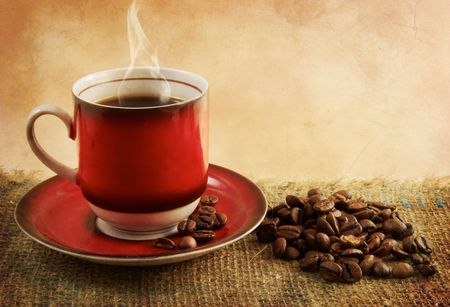 A cup of coffee and coffee beans. Vintage style