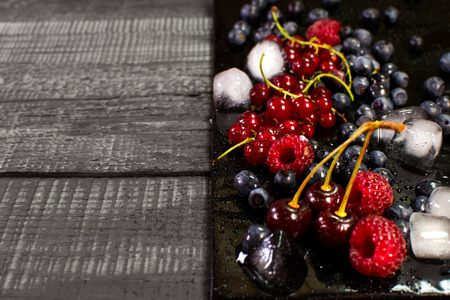 Fresh berries with ice for preparation of refreshing drinks Stock Photo