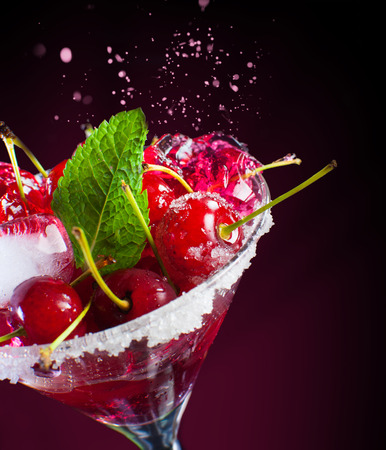 Close-up of juicy maraschino cherry on a black background.