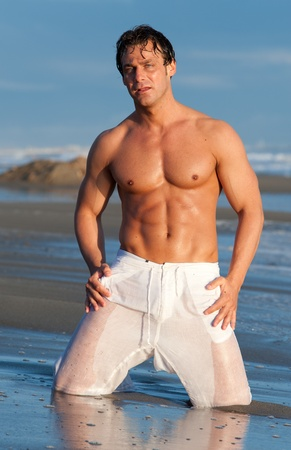 gay girl: man on the beach Stock Photo