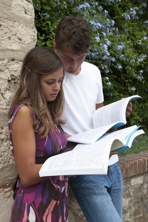 classmates: two students with book at campus Stock Photo