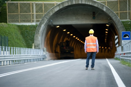 Man in front of tunnel