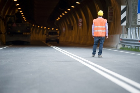 hard way: Man in front of tunnel