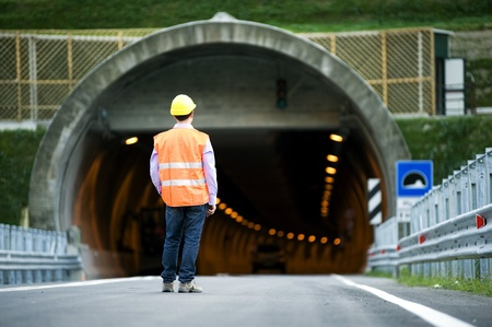 road marking: Man in front of tunnel
