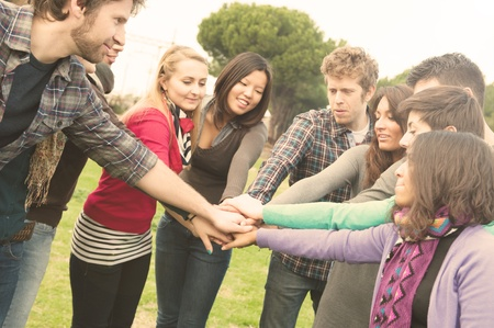 A group of Multiracial student whit hands on stack photo