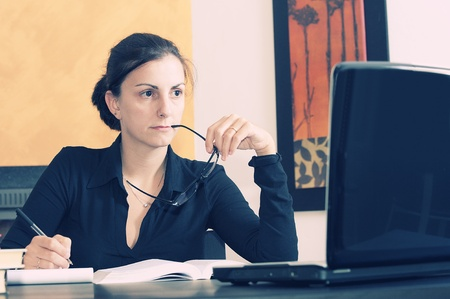 young female university student studying at table Stock Photo