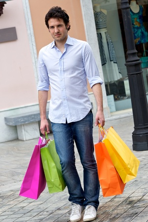 Attractive young man with shopping bags, Tuscany Italy photo