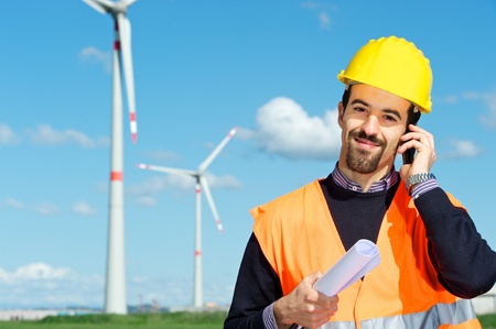 Technician Engineer in Wind Turbine Power Generator talk at phone Station, Italy photo