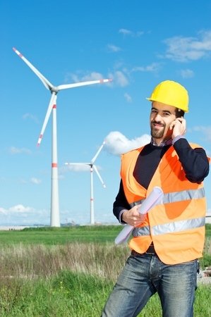 Technician Engineer in Wind Turbine Power Generator talk at phone Station, Italy Stock Photo