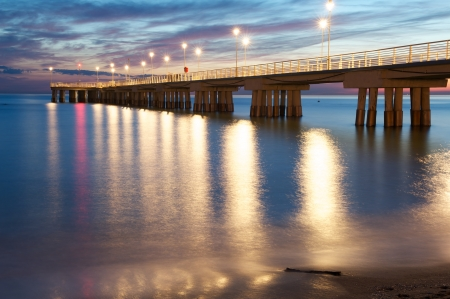 woody bay: Pier at sunset Stock Photo