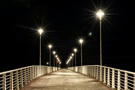 lamp posts: lamp posts on a pier at night