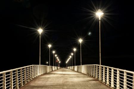 sidewalks: lamp posts on a pier at night