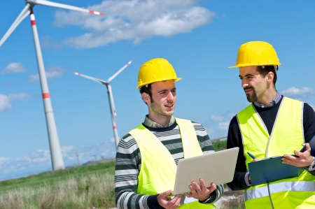 wind turbines: Two Engineers in a Wind Turbine Power Station, Italy Stock Photo