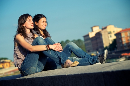 two women hugging: Two friend outdoors lifestyle