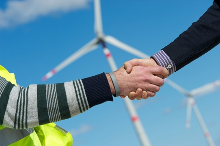Engineers giving Handshake in a Wind Turbine Power Station Italy Stock Photo