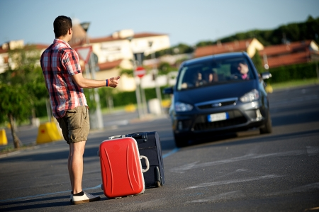 ventures: young hitchhiker on city street, Italy