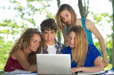 Group of young student using laptop outdoor,Italy Stock Photo