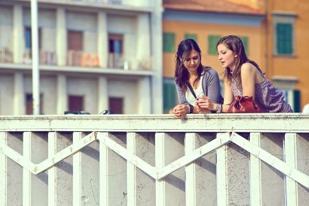 two women talking: Two Women Talking in the City,Italy
