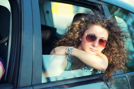 Pensive Girl Looking out of Car Window, Italy photo