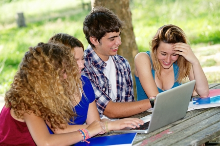 Group of young student using laptop outdoor,Italy photo