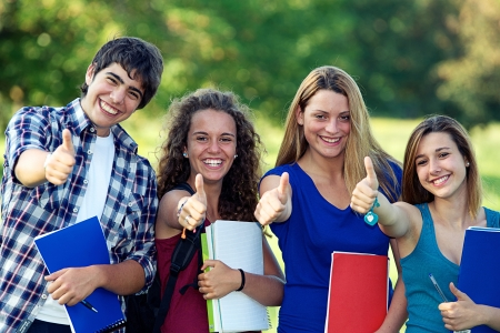 Young group of happy students showing thumbs up sign together outdoor in the park Italy photo