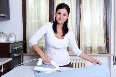 bright picture of lovely housewife with iron , Italy