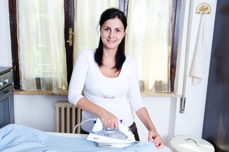 bright picture of lovely housewife with iron , Italy photo