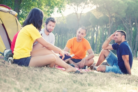 Group of People Camping and telling a story, Italy