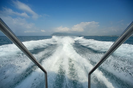 Boat wake prop wash on blue ocean sea in sunny day Italy photo