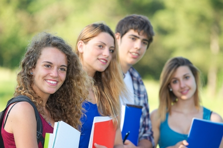 studygroup: Portrait happy young students in park,Italy