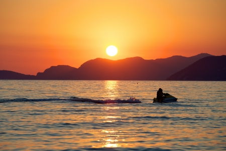 watercraft: Watercraft Sunset in the sea,Italy