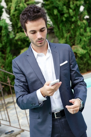 young business man with phone, Italy Stock Photo - 15041012