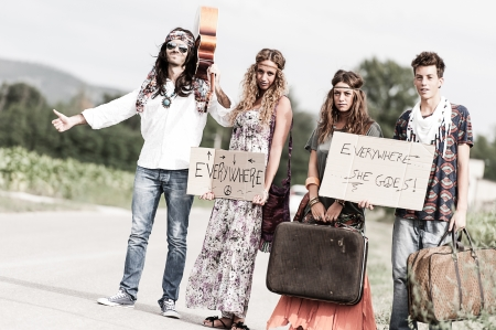man's thumb: Hippie Group Hitchhiking on a Countryside Road,Italy