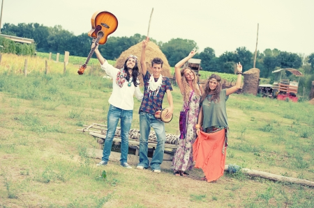Hippie Group Dancing in the Countryside,italy