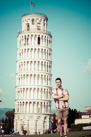 Young Man with Leaning Tower of Pisa, Italy photo