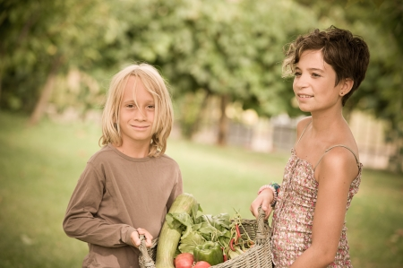 Boy and Girl Holding Basket of Vegetables,Italy photo